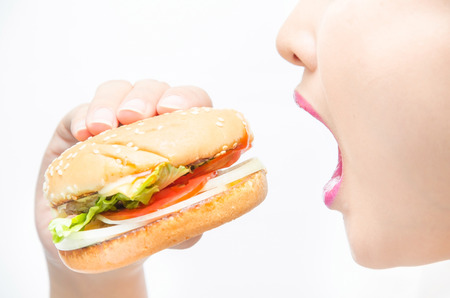 eating a hamburger. isolated on a white background Stock Photo