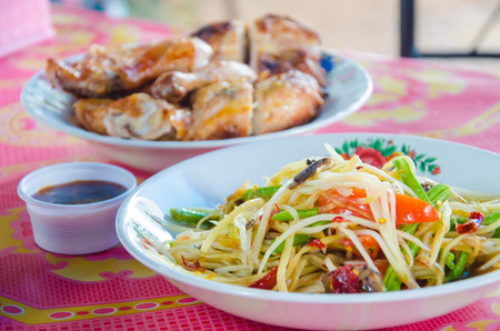 Delicious Thai food call SOMTAM and grill chicken photo