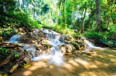 Than sawan Waterfall, Paradise waterfall in Tropical rain forest of Thailand , water fall in deep forest at border of Chaing rai and phayao province Thailand . Stock Photo