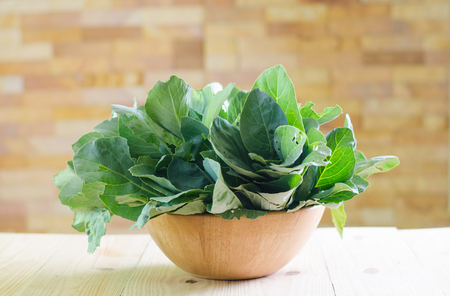 Fresh green kale in ceramic bowl Stock Photo