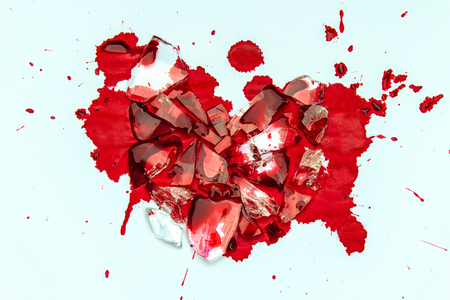 Heart of Glass has cracked and red blood Stock Photo