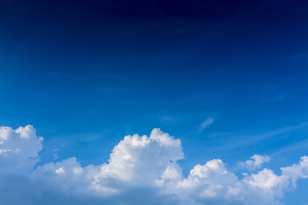 atmospheric: Deep blue sky with soft cloud Stock Photo