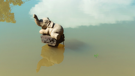 stucco: stucco elephant in water