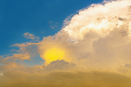 the firmament: yellow eye in cloud, Yellow circle in brown cloud with overcast blue sky Stock Photo