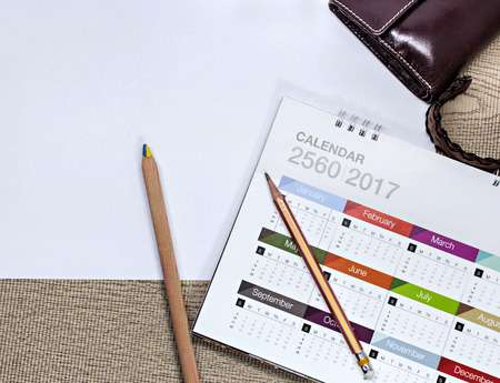 conspire: white paper and space with calendar on table
