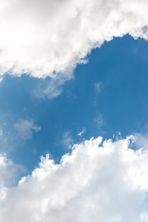 the firmament: blue sky with bright clouds