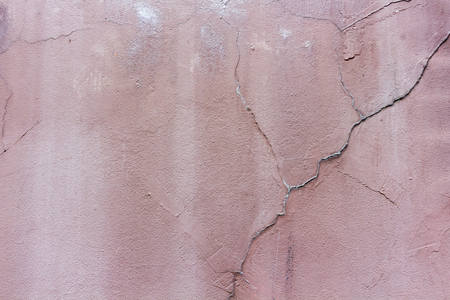 crack on Crimson cement wall with free space background