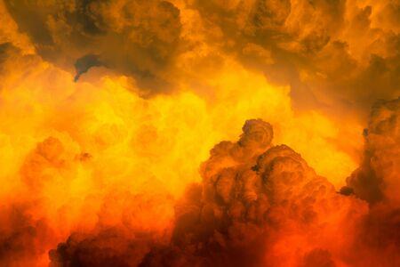 Red orange dim clouds in hot sky Zdjęcie Seryjne