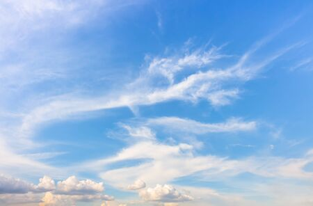 dragon tail clouds in blue sky with wind