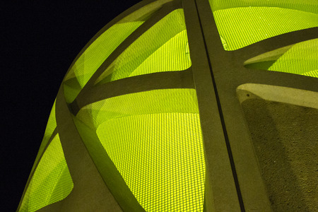 beton: Neon Green Screen in Concrete Cooling Tower at Night