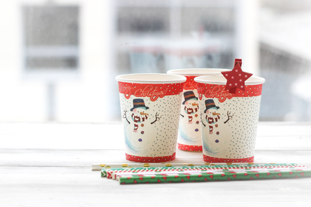 Festive still life: three glasses with a picture of a snowman Stock Photo