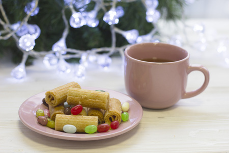 A festive still life with tea, coocies and candies