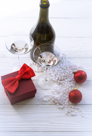 two glasses, bottle, and Christmas decorations