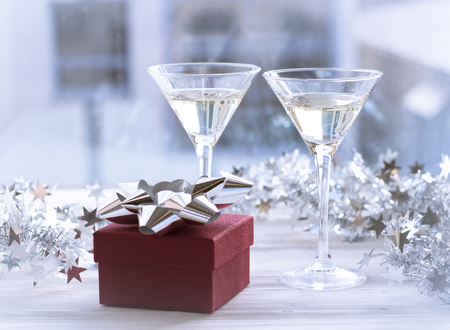 Still life with two glasses and a gift box Stock Photo