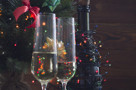 Festive still life with two glasses and a bottle of champagne