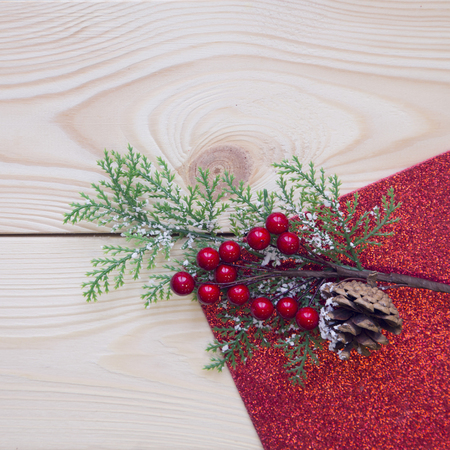 Christmas light wooden background with a branch of berries