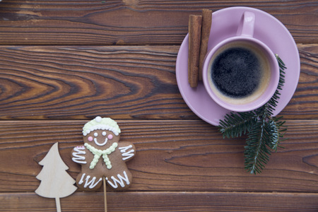 Christmas rustic wooden background with fir tree branches and coffee Stock Photo
