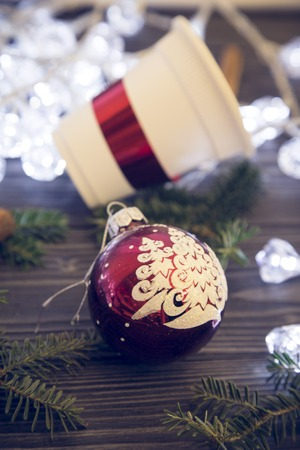 A cup and a Christmas tree ball