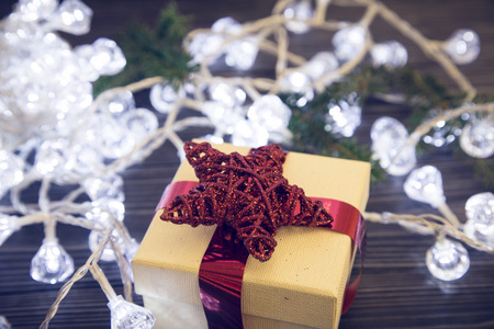 A gift box and fairy lights