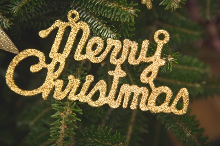 Merry christmas gold gleaming inscription Stock Photo