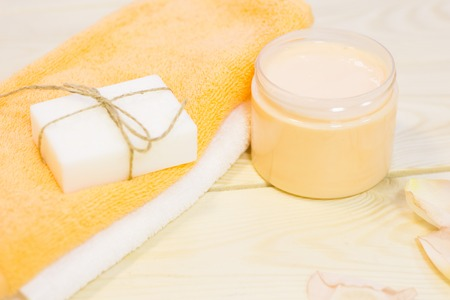Cosmetics set- a natural herbal soap, homemade cream and towels, close up. Spa and beauty consept.