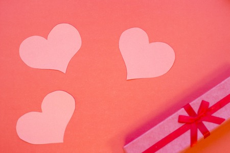 The concept of St.Valentines Day with a gift box, red background top view