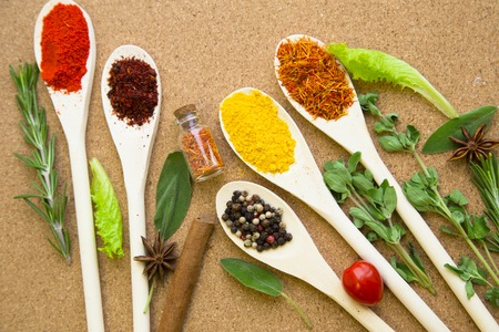 Set of spices and herbs on a corkwood Stock fotó