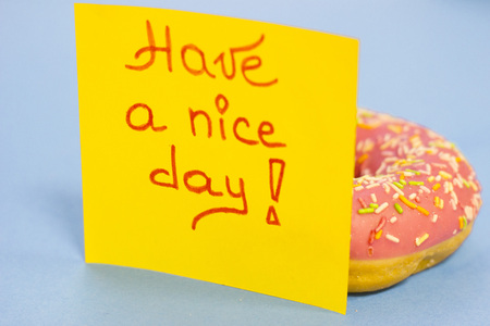 A pink glazed donut and have a nice day yellow sticker note on stock photo picture and royalty free image image 94906591
