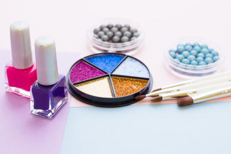 Cosmetic products on pastel colors background