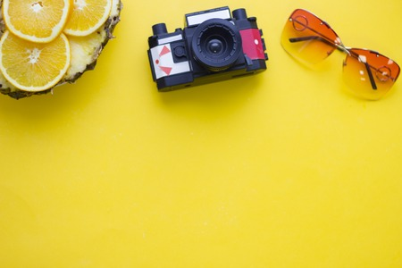 Yellow background with travelling items Archivio Fotografico