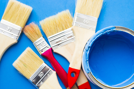 House renovation concept, paint cans and brushes