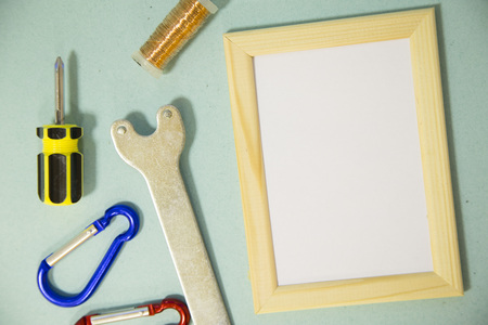Repair modern tools around a frame board on blue background, top view, copy space