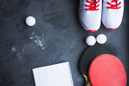 Sport fitness, weight loss concept. racket, balls, sneakers on grey rubber background. Vintage retro filter