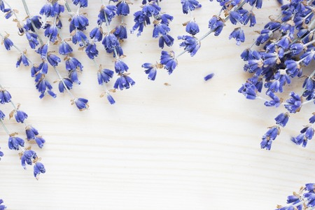 Spa and wellness setting with lavender flowers, sea salt, oil in a bottle, aroma candle on wooden white background closeup 免版税图像