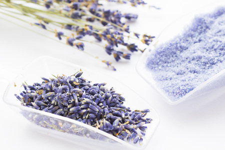 Spa and wellness setting with lavender flowers, sea salt, oil in a bottle, aroma candle on wooden white background closeup 스톡 콘텐츠 - 121661480
