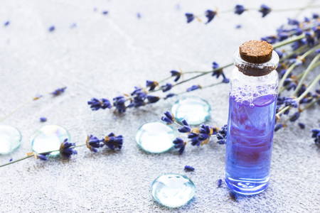 Spa and wellness setting with lavender flowers, sea salt, oil in a bottle, aroma candle on wooden white background closeup 스톡 콘텐츠 - 121661524
