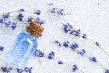 Spa and wellness setting with lavender flowers, sea salt, oil in a bottle, aroma candle on wooden white background closeup 스톡 콘텐츠 - 121661535