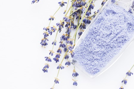 Spa and wellness setting with lavender flowers, sea salt, oil in a bottle, aroma candle on wooden white background closeup 스톡 콘텐츠 - 121661634