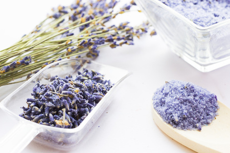 Spa and wellness setting with lavender flowers, sea salt, oil in a bottle, aroma candle on wooden white background closeup 스톡 콘텐츠
