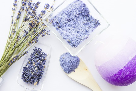 Spa and wellness setting with lavender flowers, sea salt, oil in a bottle, aroma candle on wooden white background closeup 스톡 콘텐츠 - 122691774