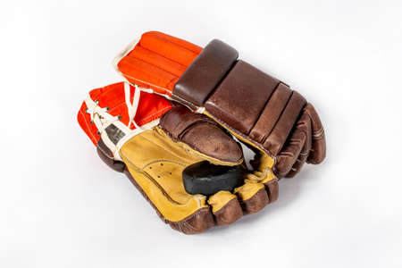Old red hockey gloves for goalkeeper. Isolated over white background