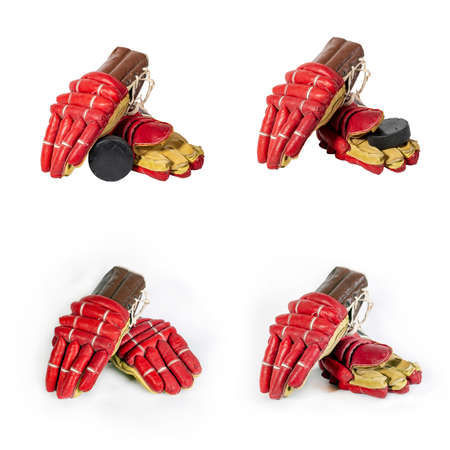 Set of Old red hockey gloves for goalkeeper. Isolated over white background