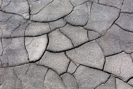 Drought, dried cracked earth. Cracks in clay. Water shortage problem