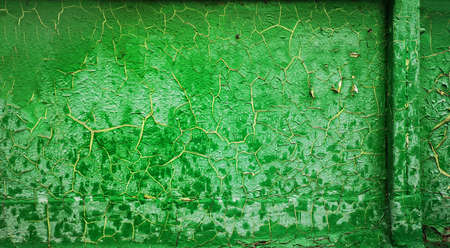 Old cracked green paint. Background texture closeup.