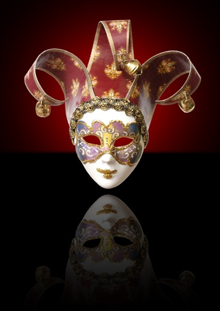 fool: One venetian mask on a black background