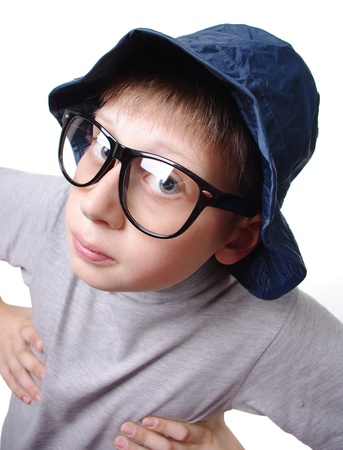 staunch: Funny teenager with cap, glasses isolated on a white