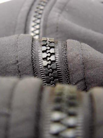 A zipper of a jacket close-up
