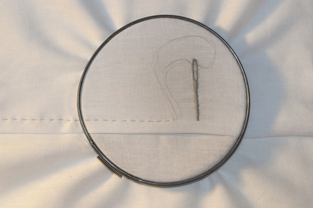 meticulous: Embroidery hoop with running stitch and needle on cotton fabric  Stock Photo