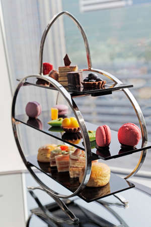 Chocolate is a set menu for afternoon tea  Include water, tea, bread, ham Macaron Pie Strawberry Cake  photo