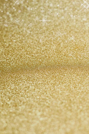 edel: Christmas on background in gold with sparkling stars